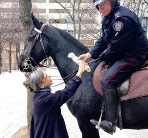 Constable Joel Houston hands over new hooks