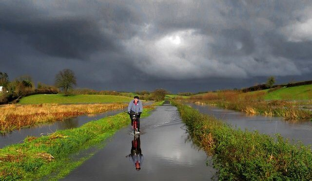 bicycle and cyclist in storm