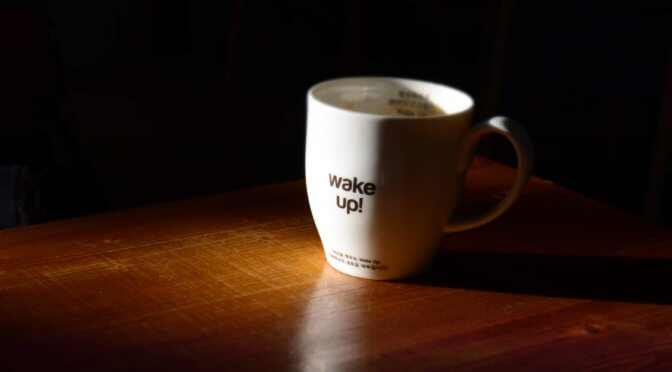 "photo of a coffee mug that says ""wake up!"""
